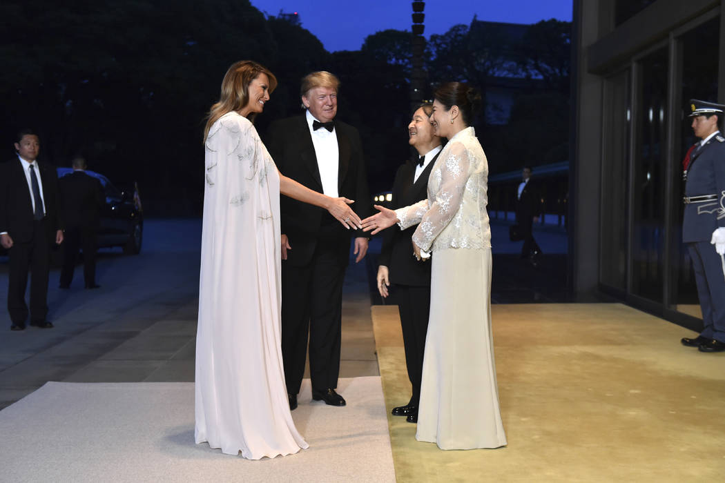 President Donald Trump, center left, and first lady Melania Trump, front left, are greeted by J ...