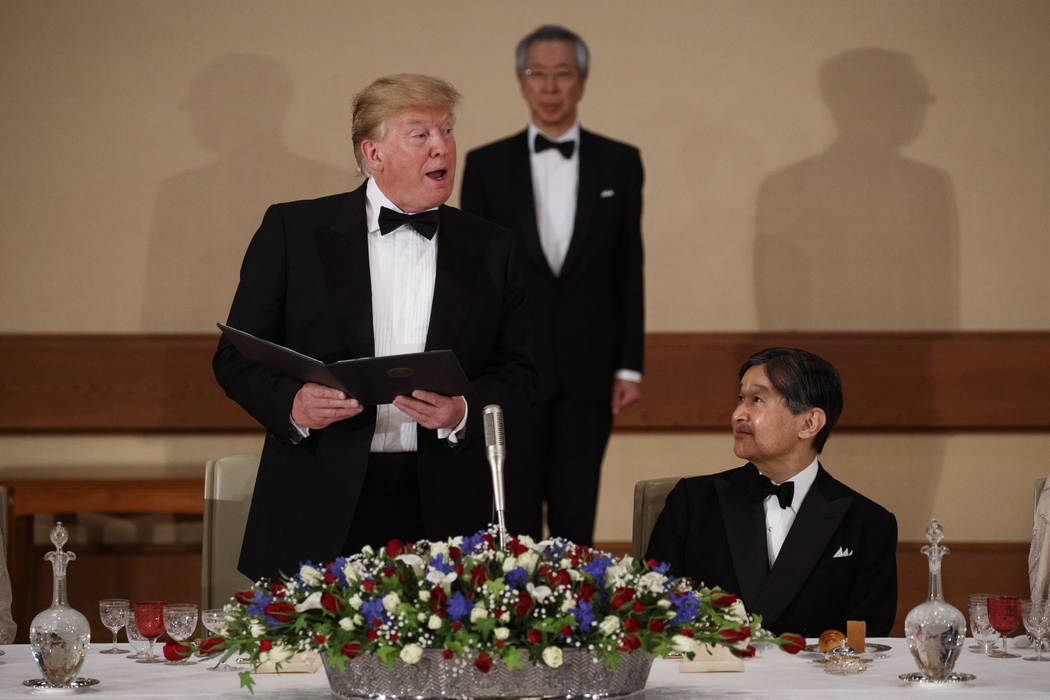 Japan's Emperor Naruhito, right, looks on as President Donald Trump speaks during a State Banqu ...