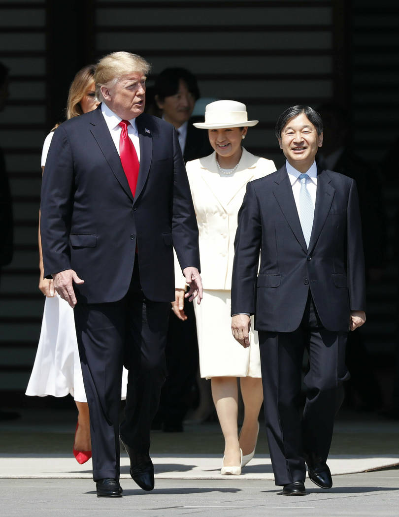 U.S. President Donald Trump, left, and first lady Melania Trump, rear left, are escorted by Jap ...