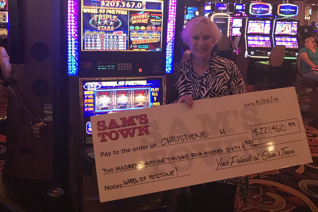 Las Vegas resident Christiene H. shows off her winnings Saturday, May 25, 2019, after she hit I ...