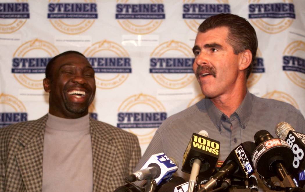 Mookie Wilson, a former player with the New York Mets, laughs as former Boston Red Sox' player ...