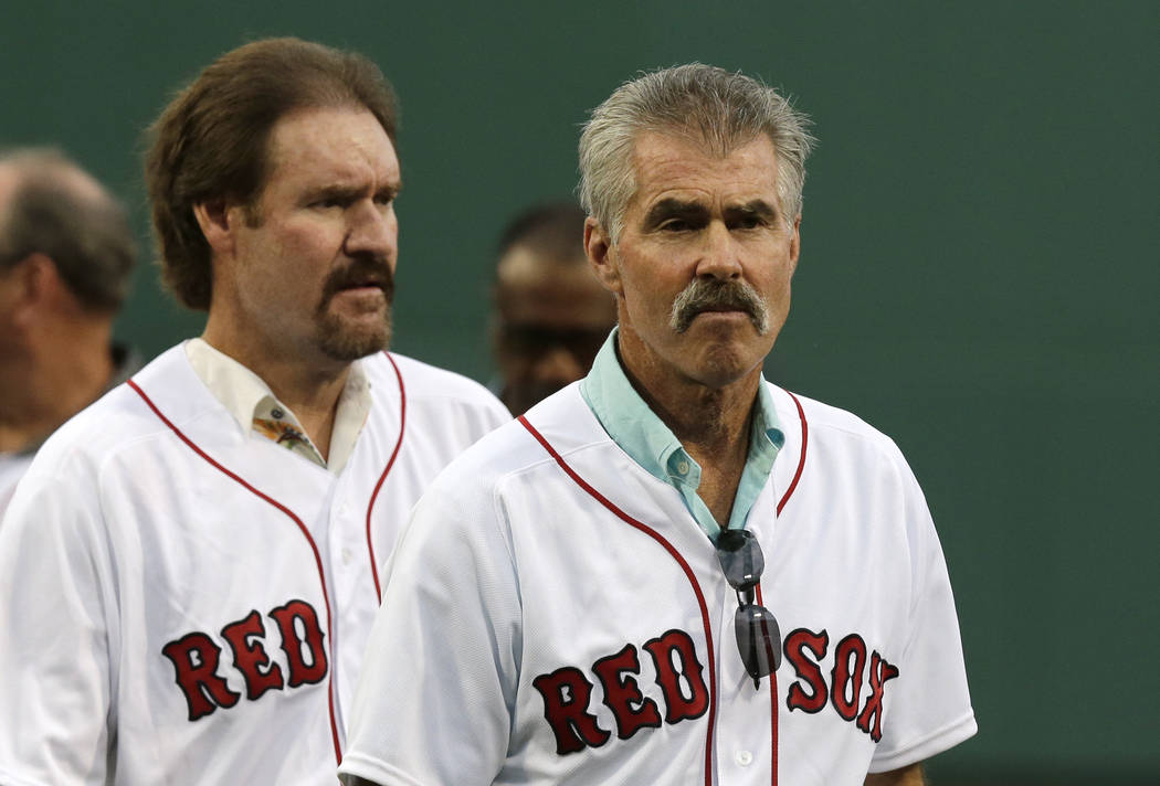 Former Boston Red Sox's players Bill Buckner, right, and Wade Boggs prior to a baseball game ag ...