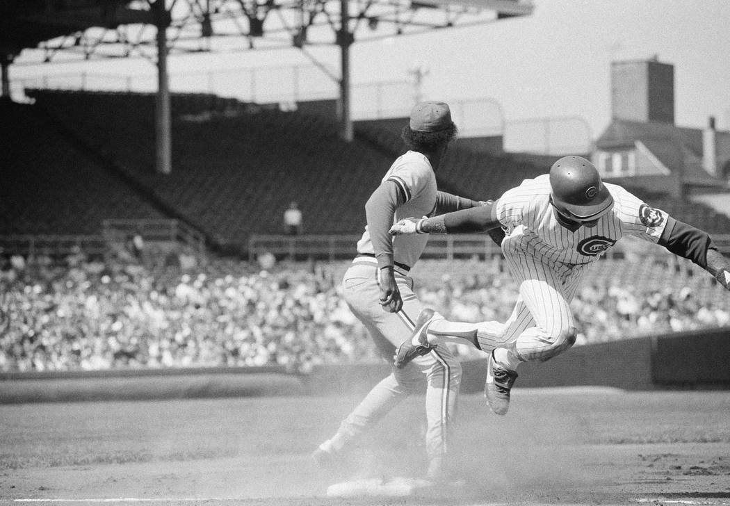 Chicago Cubs Bill Buckner flies over first, stumbling on the base as he was forced out by St. L ...