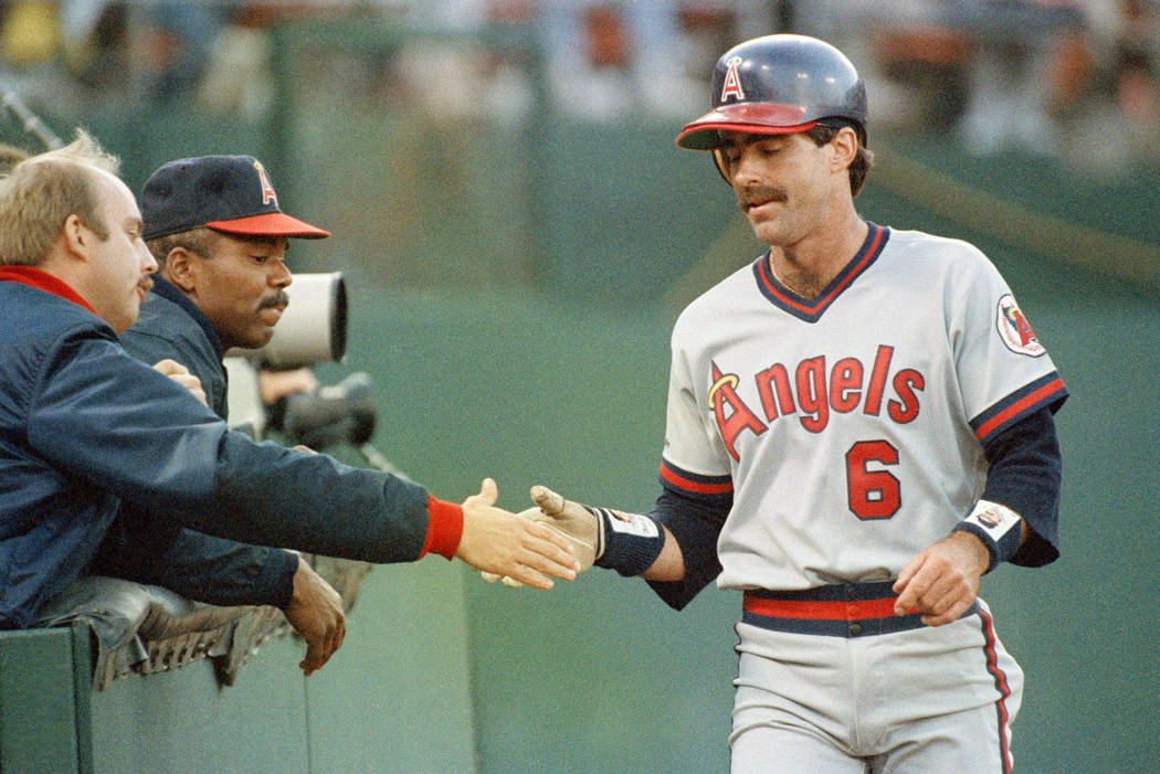 Newly signed first baseman Bill Buckner, right, is congratulated by teammates Ned Bergert, left ...