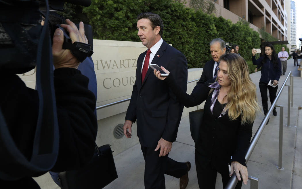 FILE - In this Dec. 3, 2018 file photo Republican Rep. Duncan Hunter, center, leaves court in S ...