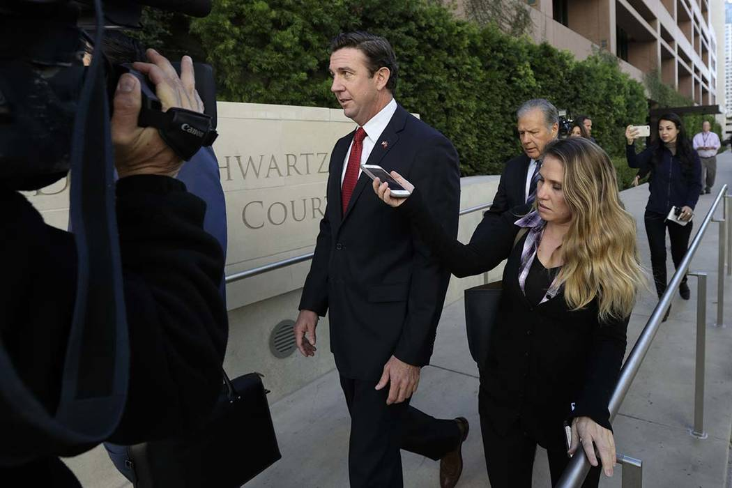 Republican Rep. Duncan Hunter, center, leaves court in San Diego, Dec. 3, 2018. Hunter has ackn ...