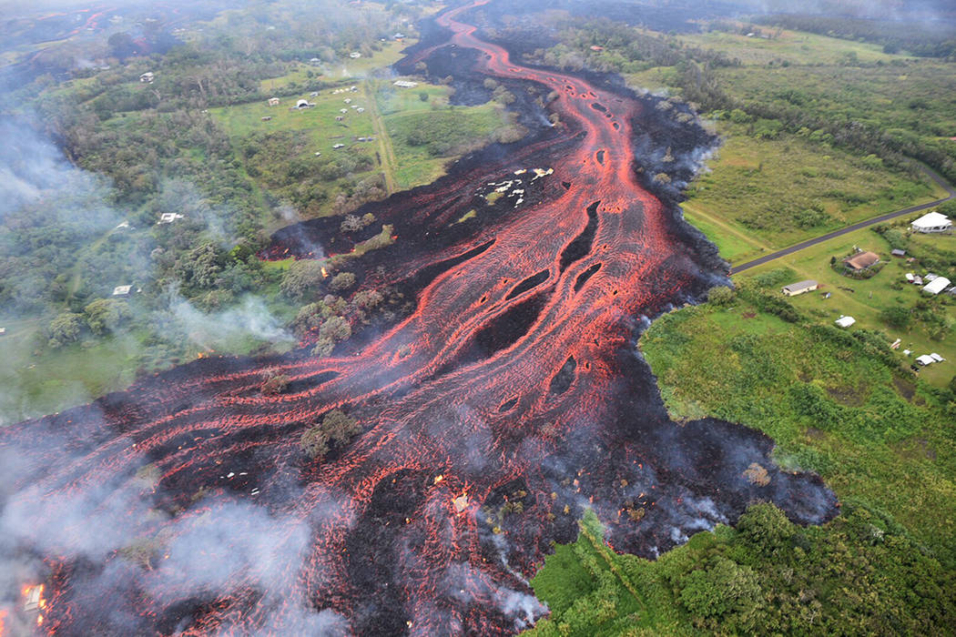 In this Saturday, May 19, 2018, photo released by the U.S. Geological Survey, lava flows from f ...