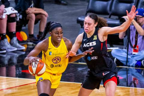 Los Angeles Sparks forward/center Chiney Ogwumike (13) drives the lane defended by Las Vegas Ac ...