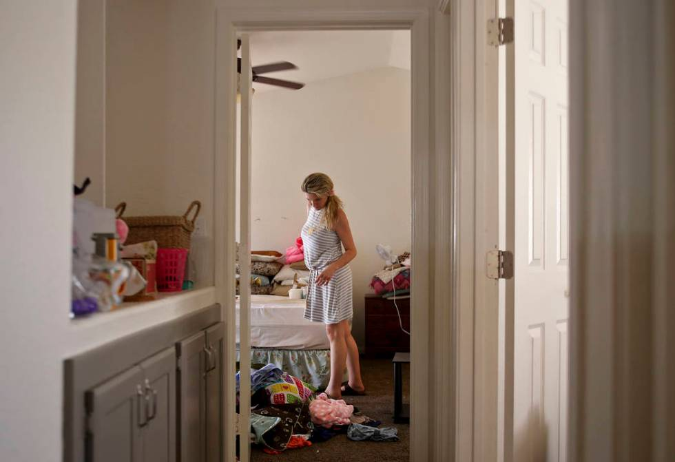 Kari Monson packs her belongings after being evicted for failure to pay rent in Las Vegas, Mond ...