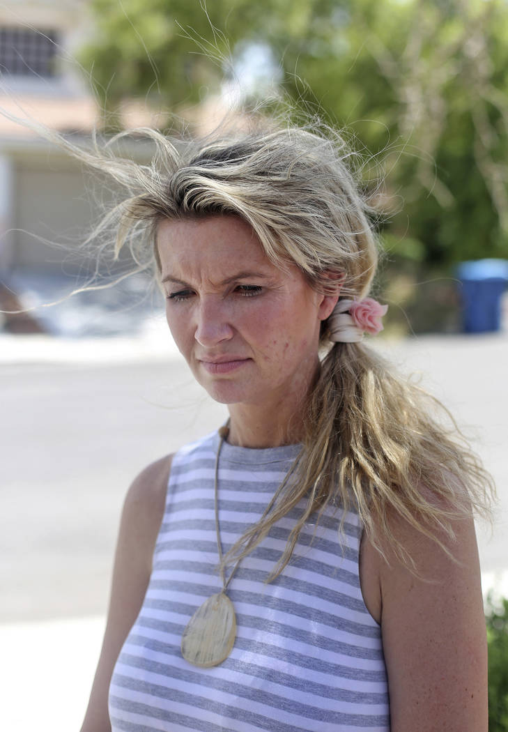 Kari Monson outside her former home in Las Vegas, Monday, Aug. 20, 2018. She was evicted after ...
