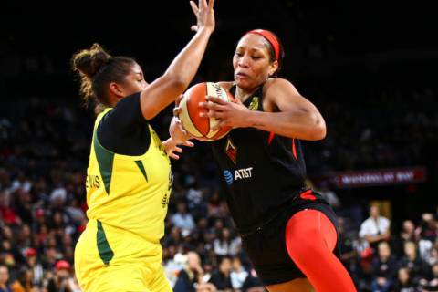Las Vegas Aces center A'ja Wilson, right, drives to the basket against Seattle Storm forward Ka ...