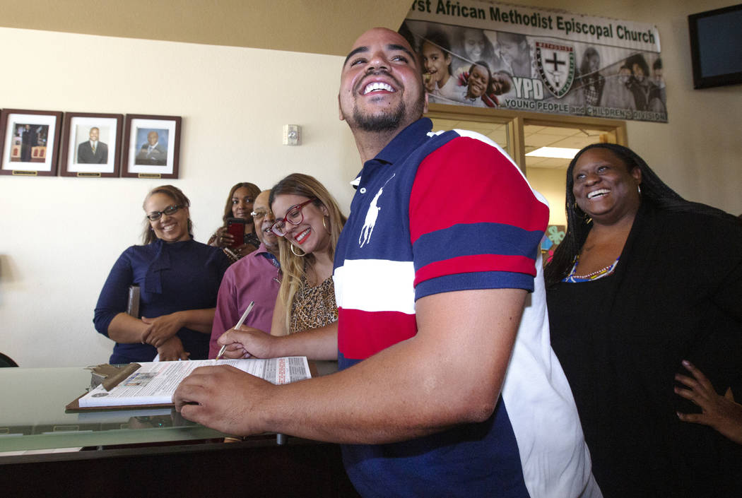 Jovan Jackson, 27, registers to vote with the help of Emily Zamora, left, of Silver State Voice ...