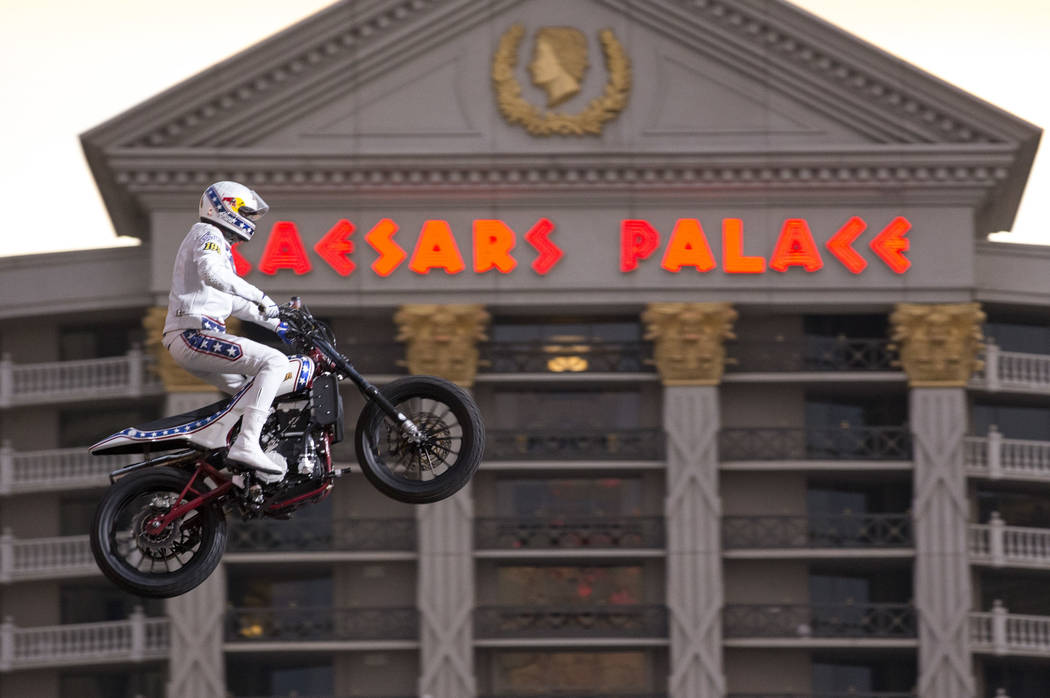 Travis Pastrana jumps over the fountains at Caesars Palace on an Indian Scout FTR750 motorcycle ...