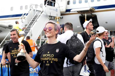 United States women's soccer team member Megan Rapinoe holds the Women's World Cup trophy after ...