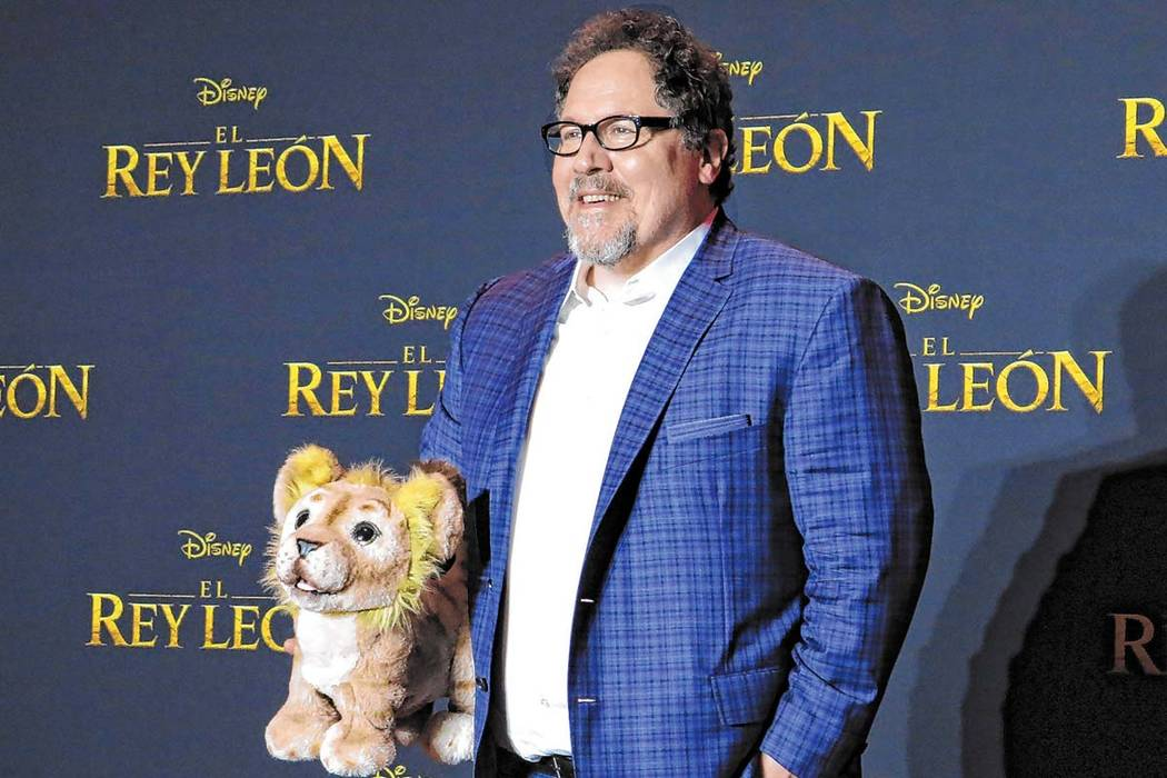 """Director Jon Favreau poses during a news conference to promote his film, """"The Lion King"""" on Jun ..."""
