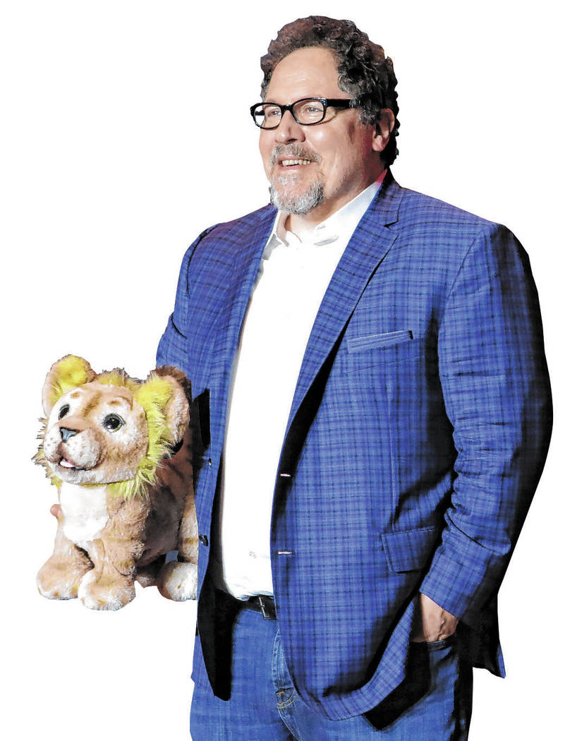 """Director Jon Favreau poses during a press conference to promote his film, """"The Lion King&q ..."""