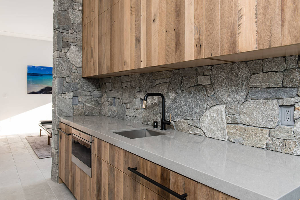 The home includes lots of nature stone and wood. (Jewel Homes)