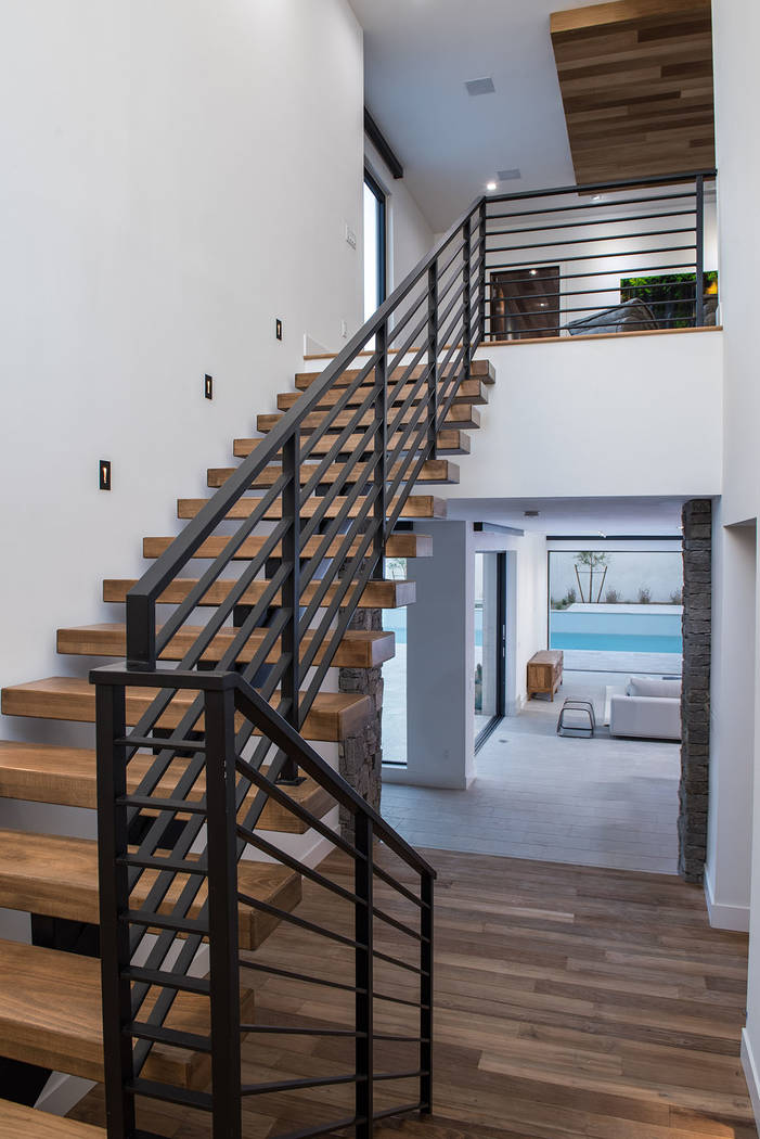 The two-story home has a modern layered design. (Jewel Homes)