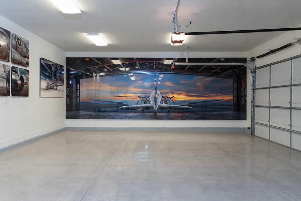 Even the garage in the luxury home features Peter Lik's photography. (Jewel Homes)
