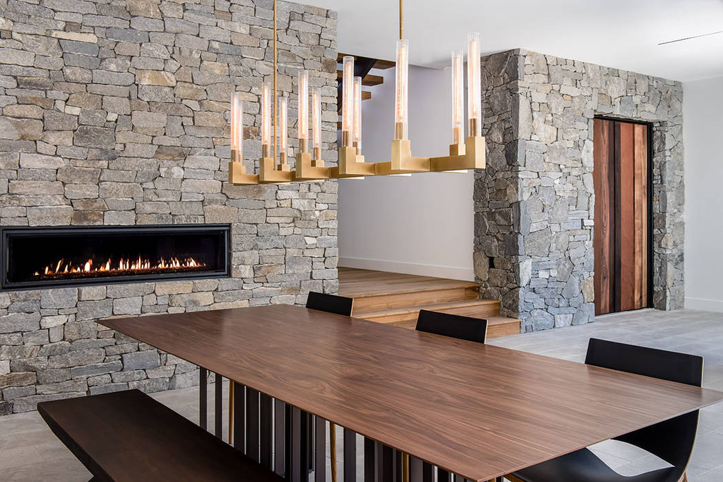 The dining room features a fireplace. (Jewel Homes)