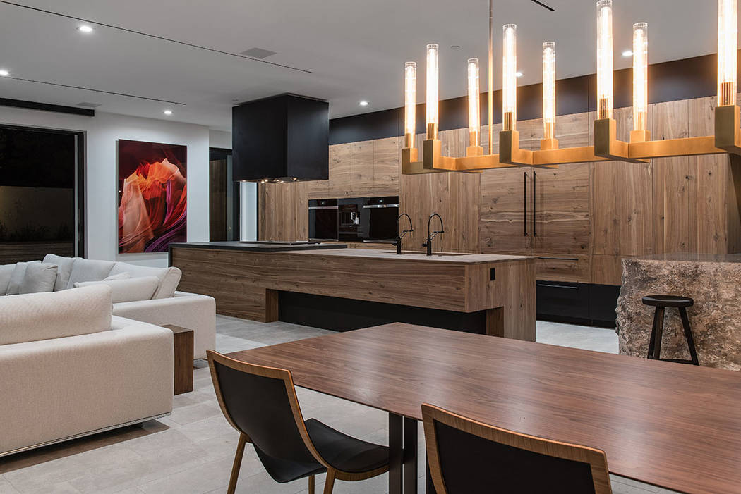 The kitchen and dining area opens to the pool area. (Jewel Homes)