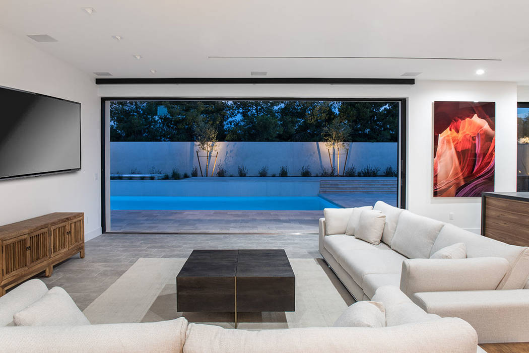 The great room opens to the pool area. (Jewel Homes)