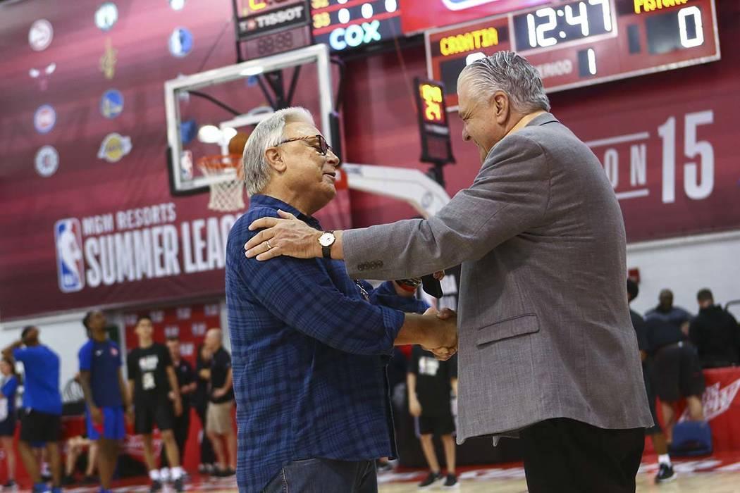 Warren LeGarie, executive director of the Vegas Summer League, left, talks with Gov. Steve Siso ...