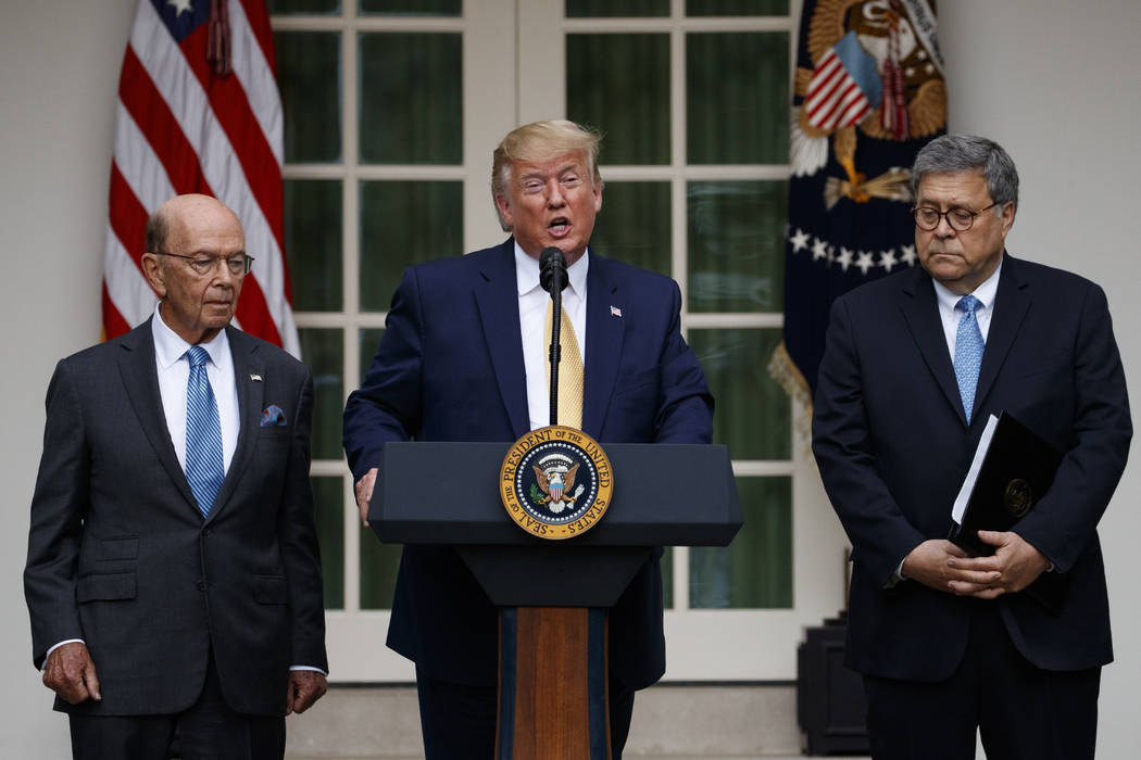 President Donald Trump, joined by Commerce Secretary Wilbur Ross, left, and Attorney General Wi ...