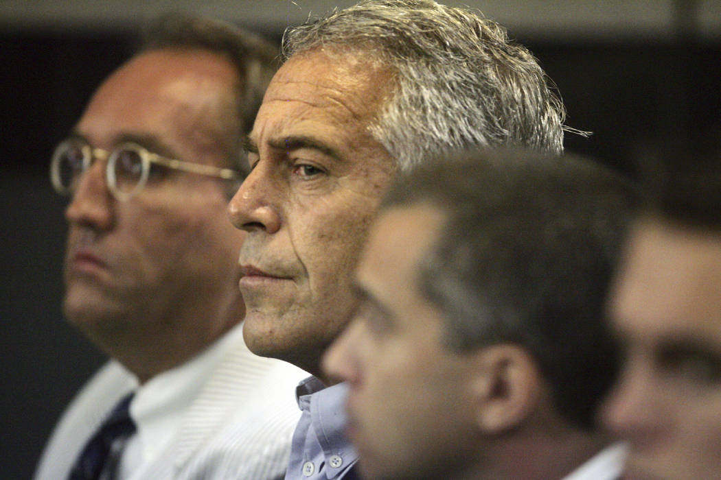 FILE - In this July 30, 2008, file photo, Jeffrey Epstein, center, appears in court in West Pal ...
