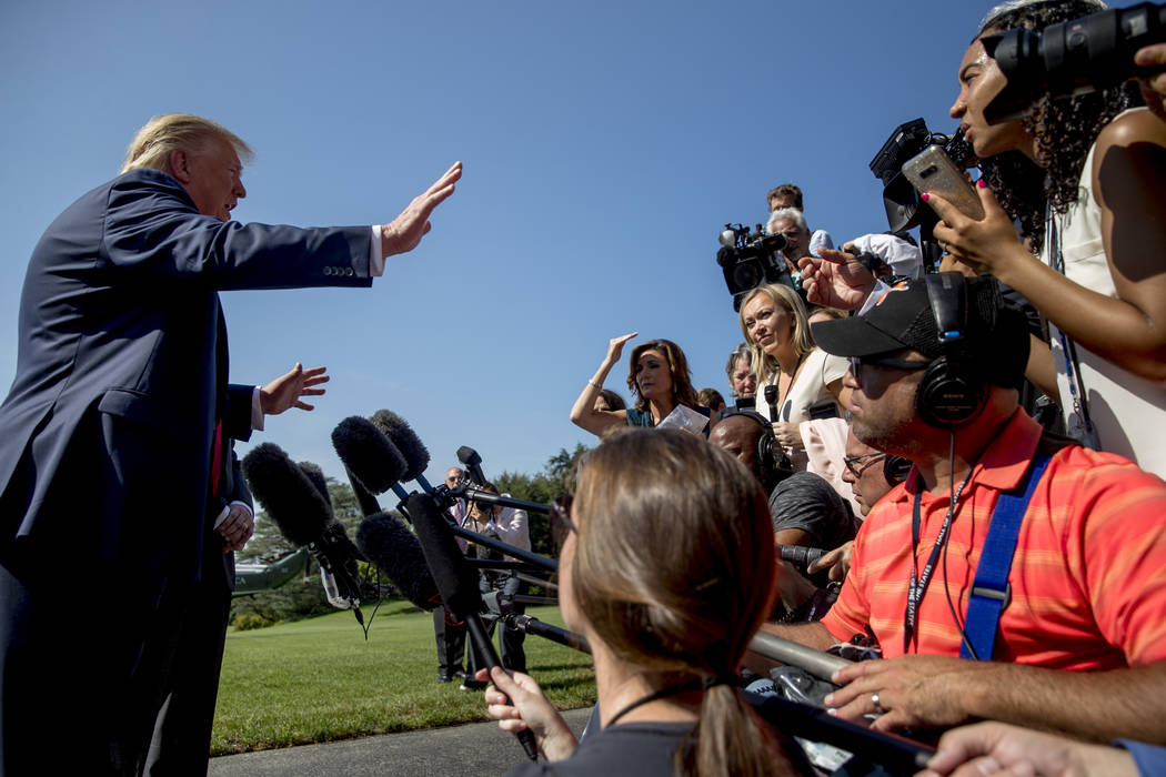 President Donald Trump speaks to members of the media on the South Lawn of the White House in W ...