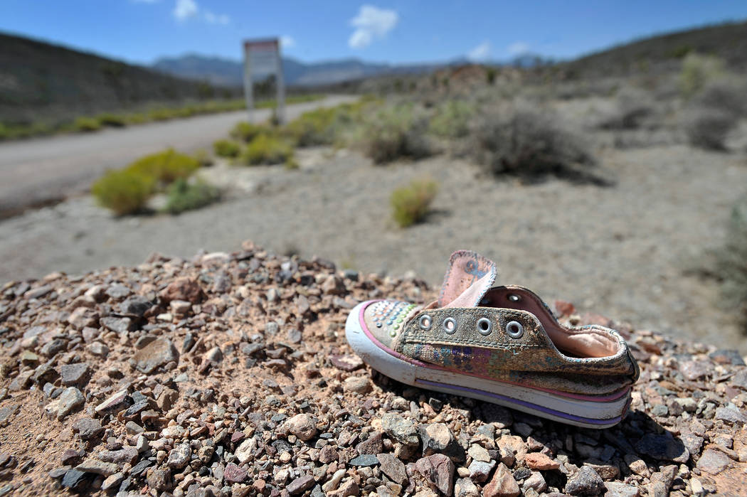 A child's shoe is seen near the perimeter of the well-guarded military installation on Tuesday, ...