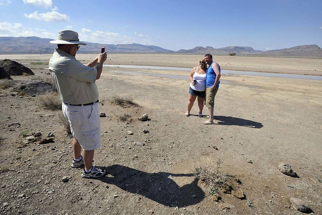Dean Baumgartner, left, of Adventure Photo Tours, photographs Becky Cooper and Shane Cooper of ...