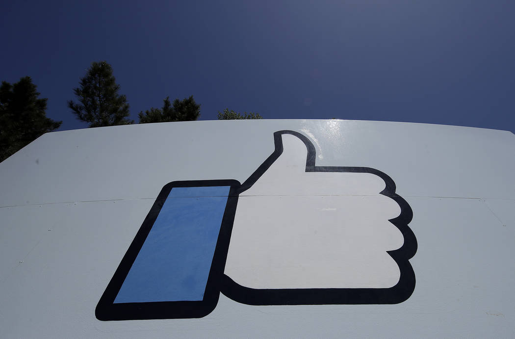 "An April 25, 2019, file photo shows the thumbs-up ""Like"" logo on a sign at Facebook headquarter ..."
