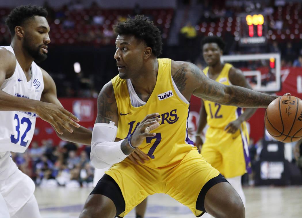 Los Angeles Lakers' Jordan Caroline drives into New York Knicks' Zak Irvin during the second ha ...