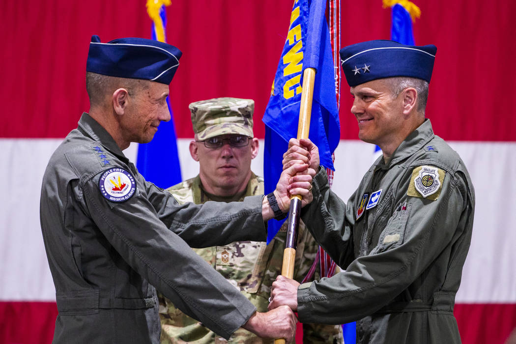 Gen. Mike Holmes, Commander of Air Combat Command, left, hands over the command flag to Maj.Gen ...