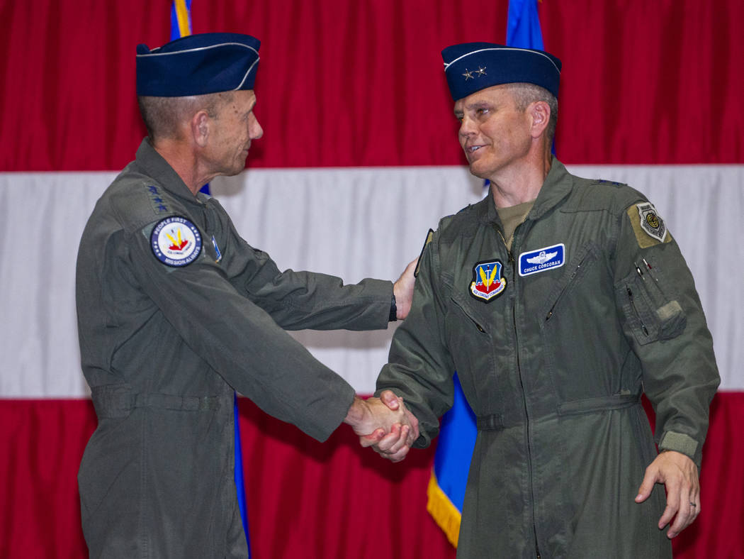 Gen. Mike Holmes, Commander of Air Combat Command, left, and Maj. Gen. Charles Corcoran shake h ...
