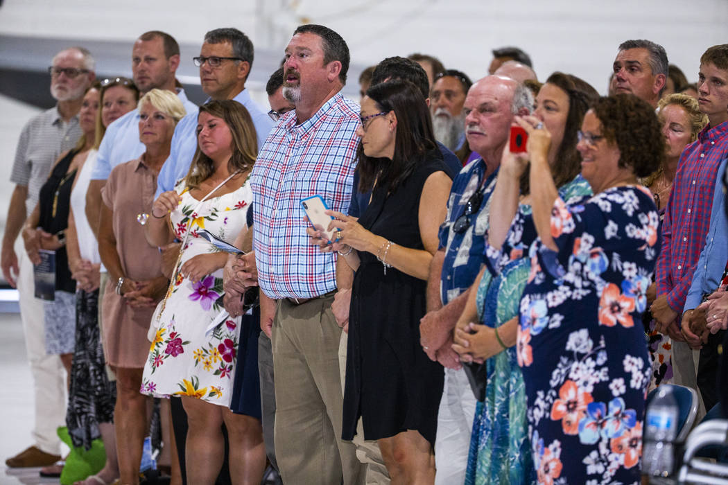 Family, friends and invited guests stand during the Assumption of Command Ceremony for Major Ge ...