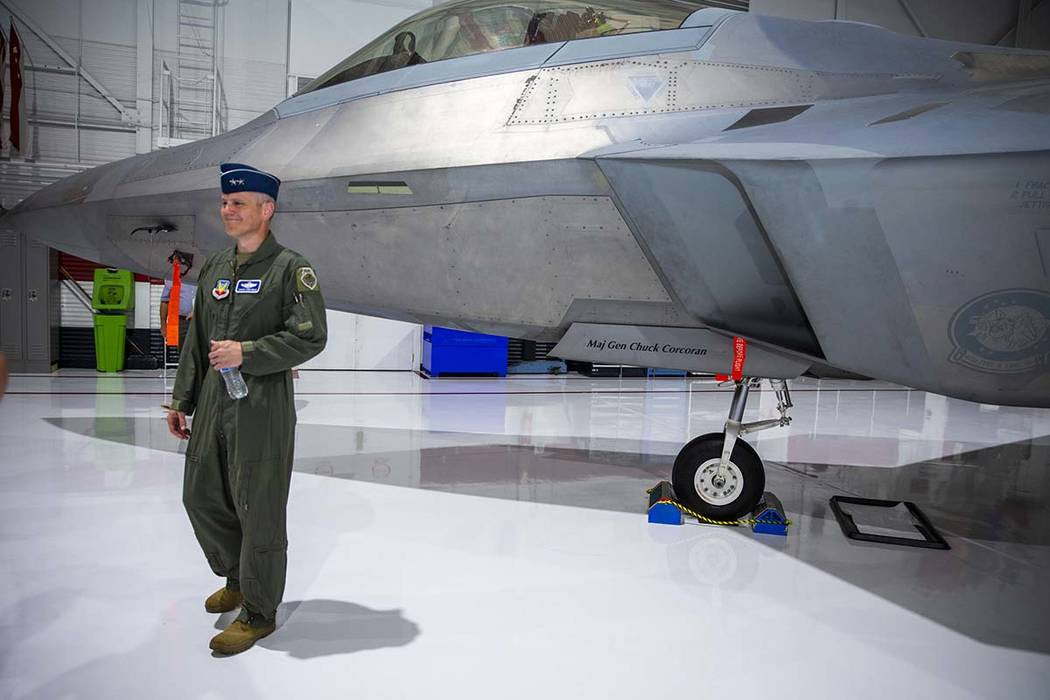 Maj. Gen. Charles Corcoran stands next to his fighter jet after he assumed command of the U.S. ...