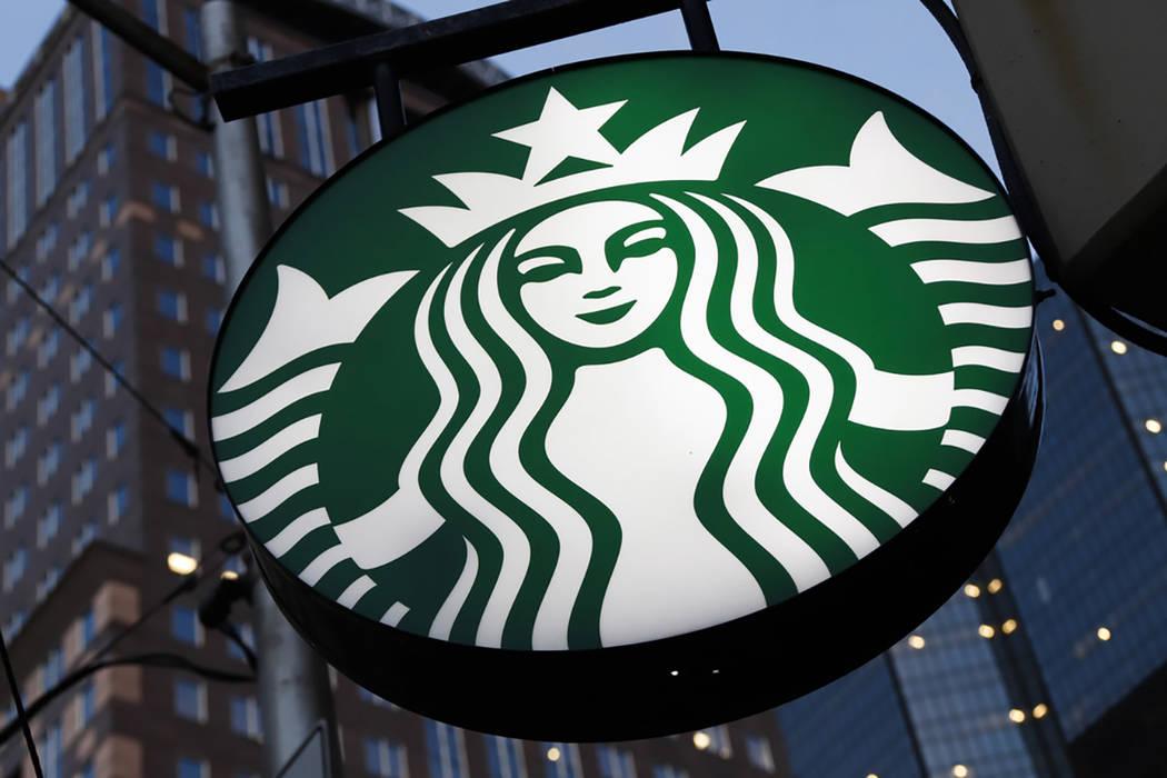 A Starbucks sign outside a Starbucks coffee shop in downtown Pittsburgh. (AP Photo/Gene J. Puskar)