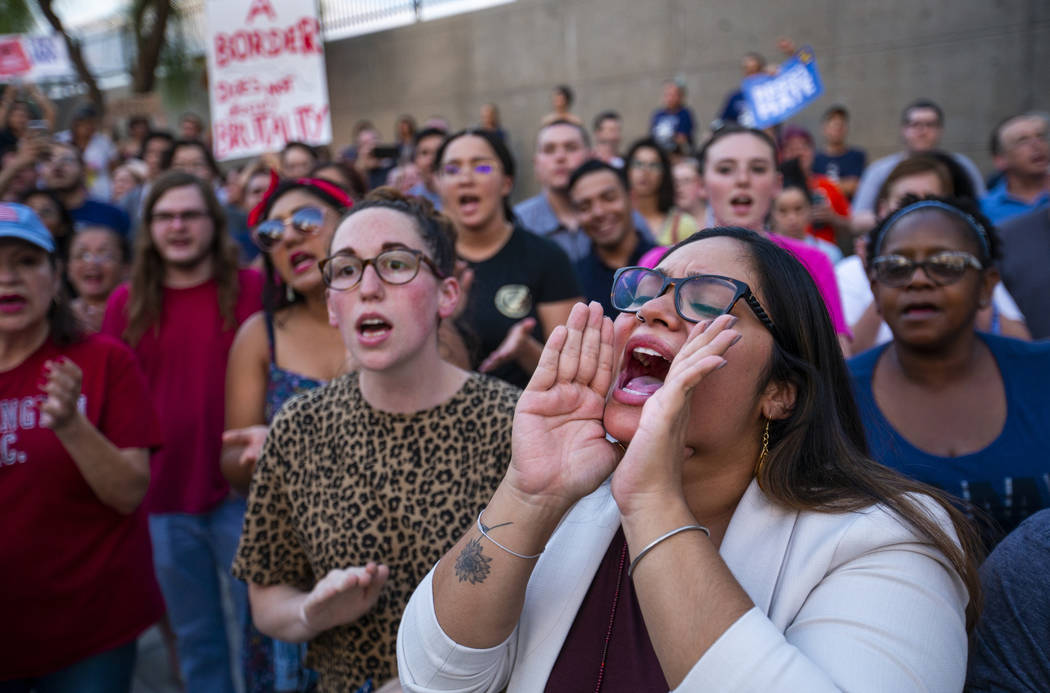 Activist Cecelia Gonzalez yells out a chant response during Lights for Liberty: A Vigil to End ...