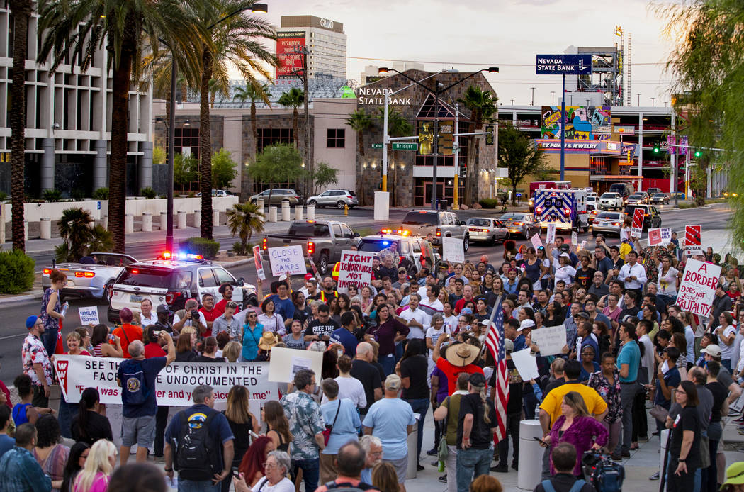 Advocates, activists and impacted persons gather for protest chants during Lights for Liberty: ...