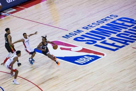 Atlanta Hawks' Tahjre McCall (8) brings the ball up court past Washington Wizards' Justin Robin ...