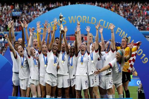 United States' team celebrates with trophy after winning the Women's World Cup final soccer mat ...