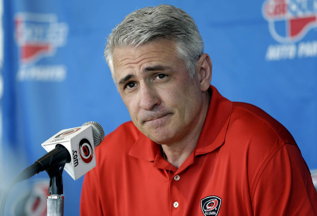 Ron Francis, at the time the general manager of the Carolina Hurricanes, takes questions from m ...