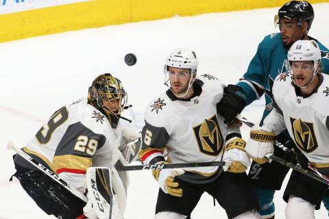 Golden Knights goaltender Marc-Andre Fleury (29) makes a save in the first period with the help ...