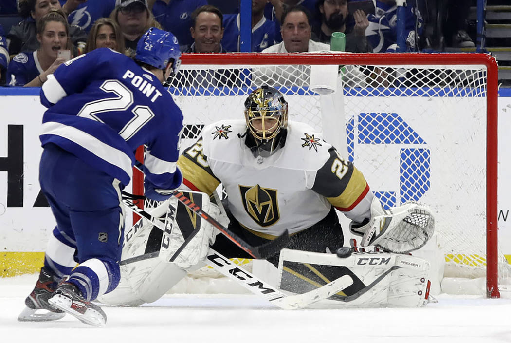 Vegas Golden Knights goaltender Marc-Andre Fleury (29) stops a shot by Tampa Bay Lightning cent ...