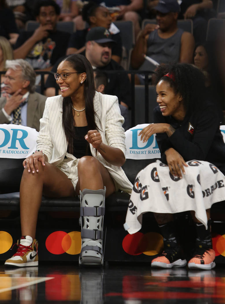 Las Vegas Aces center A'ja Wilson cheers on her team with fellow Aces player, guard Tamera Youn ...