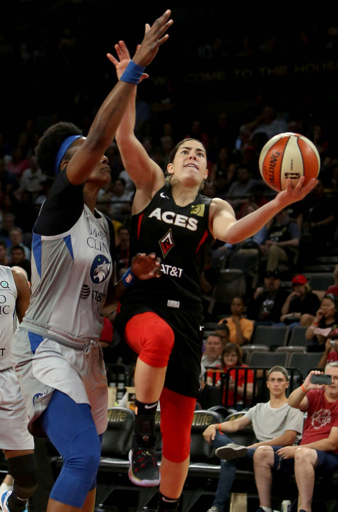 Las Vegas Aces point guard Kelsey Plum (10), right, fights to the hoop against Minnesota Lynx c ...