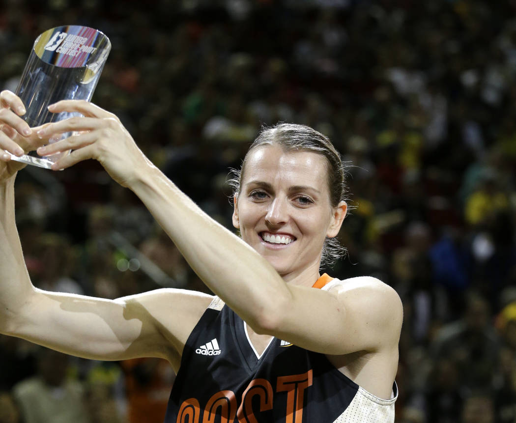 Chicago Sky's Allie Quigley holds up the trophy after winning the three-point contest at the WN ...