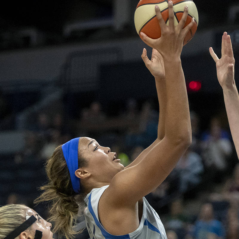 Minnesota Lynx Napheesa Collier goes up to the basket for two defended by Mystics' Elena Delle ...